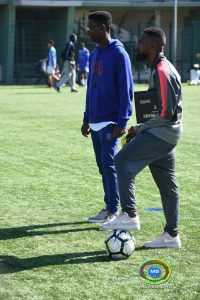 Coaches Jeoboam and Kampos look on during a training session