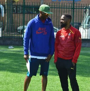 Coaches Jeoboam and Kampos confer during training session
